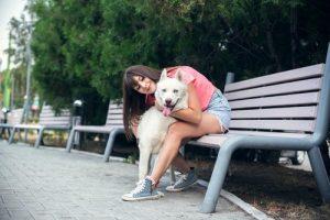 Shutterstock woman petting dog